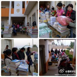 道明小学的老师们正在整理和登记接收到的捐赠物品。
