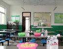 为贫困小学捐建食堂