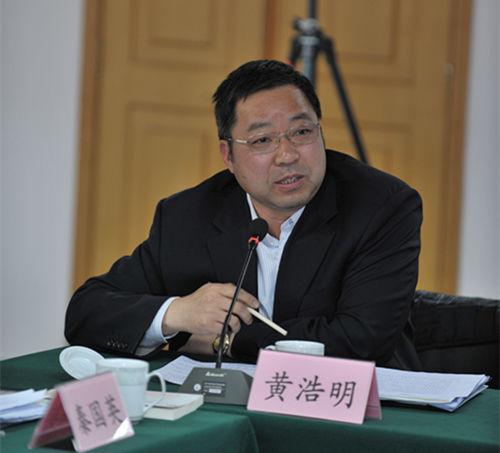 中国国际民间组织合作促进会副理事长兼秘书长黄浩明
